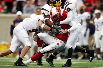 LOUISVILLE,KY - OCTOBER 2:  J.R. Russell #3 of Louisville runs after a reception against East Carolina during the game at Papa John's Stadium on October 2, 2004 in Louisville, Kentucky.  (Photo by Andy Lyons/Getty Images)