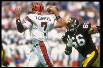 19 Sep 1993: Quarterback David Klingler of the Cincinnati Bengals looks to pass the ball as a Pittsburgh Steelers player rushes him during a game at Three Rivers Stadium in Pittsburgh, Pennsylvania. The Steelers won the game, 34-7.