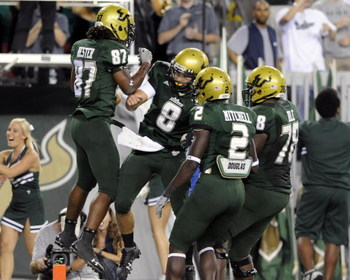 TAMPA, FL - OCTOBER 2:  Wide receiver Jessie Hester #87 of the University of South Florida Bulls celebrates a fourth-quarter touchdown pass with quarterback Matt Grothe #8 against the Pittsburgh Panthers at Raymond James Stadium on October 2, 2008 in Tamp
