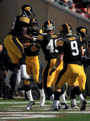 TAMPA, FL - JANUARY 01:   The Iowa Hawkeyes celebrate after an interception by Paki O'Meara #25 against the South Carolina Gamecocks during the Outback Bowl on January 1, 2009 at Raymond James Stadium in Tampa, Florida.  (Photo by Scott Halleran/Getty Ima