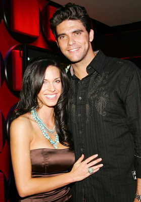 LAS VEGAS - AUGUST 06:  Tennis player Mark Philippoussis (L) and Amanda Salinas pose after watching the finale of the television show 'Age of Love' at the EXTRA Lounge at the Planet Hollywood Resort & Casino August 6, 2007 in Las Vegas, Nevada. Salinas wa