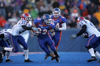 BOISE, ID - NOVEMBER 20:  Running back Jon Helmandollar #33 of Boise State carries the ball against strong saftey Bo Cox #31 of Louisiana Tech during the game at Bronco Stadium on November 20, 2004 in Boise, Idaho. Boise State defeated Louisiana Tech 55-1