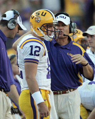 BATON ROUGE, LA - OCTOBER 25:  Coach Les Miles talks with quarterback Jarrett Lee #12 of Louisiana State during their football game against Georgia at Tiger Stadium on October 25, 2008 in Baton Rouge, Louisiana. Georgia won 52-38.  (Photo by Dave Martin/G