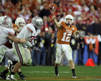 GLENDALE, AZ - JANUARY 05:  Quarterback Colt McCoy #12 of the Texas Longhorns throws a pass against the Ohio State Buckeyes during the Tostitos Fiesta Bowl Game on January 5, 2009 at University of Phoenix Stadium in Glendale, Arizona.   The Longhorns defe