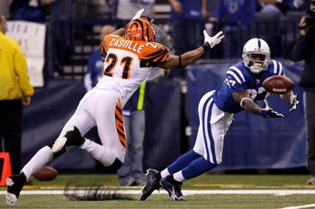 INDIANAPOLIS - DECEMBER 07:  Reggie Wayne #87 of the Indianapolis Colts can't make a play on a ball thrown to him against Simeon Castille #21 of the Cincinnati Bengals at Lucas Oil Stadium on December 7, 2008 in Indianapolis, Indiana.  (Photo by Andy Lyon