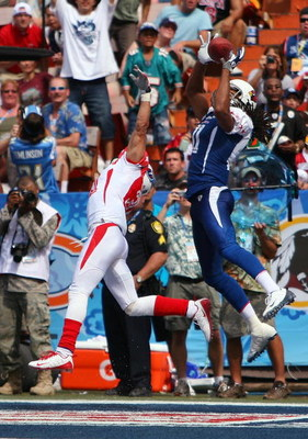 HONOLULU, HI - FEBRUARY 08: Wide receiver Larry Fitzgerald #11 of the NFC All-Stars Arizona Cardinals leaps and catches a 2 yard touchdown pass while covered by cornerback Cortland Finnegan #31 of the AFC All-Stars Tennessee Titans in the 2009 NFL Pro Bow