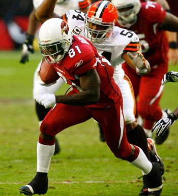 GLENDALE, AZ - DECEMBER 2:  Wide receiver Anquan Boldin #81 of the Arizona Cardinals eludes linebacker Andra Davis #54 of the Cleveland Browns during a 27-21 win at University of Phoenix Stadium December 2, 2007 in Glendale, Arizona.  (Photo by Kevin Terr