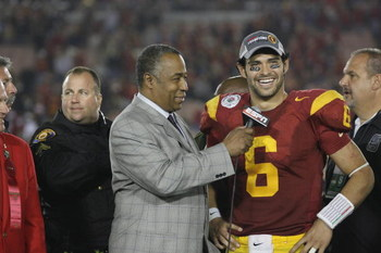 PASADENA, CA - JANUARY 1:  Mark Sanchez #6 of the USC Trojans smiles as he is interviewed by John Saunders of ABC after the game against the Penn State Nittany Lions on January 1, 2009 at the Rose Bowl in Pasadena, California.  USC won 38-24.  (Photo by J