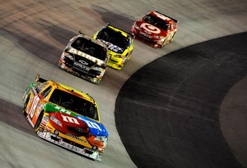 BRISTOL, TN - AUGUST 22: Kyle Busch, driver of the #18 M&M's Toyota, leads Ryan Newman, driver of the #39 Haas Automation Chevrolet, Mark Martin, driver of the #5 Pop Tarts/CARQUEST Chevrolet, and Juan Pablo Montoya, driver of the #42 Target Chevrolet, du