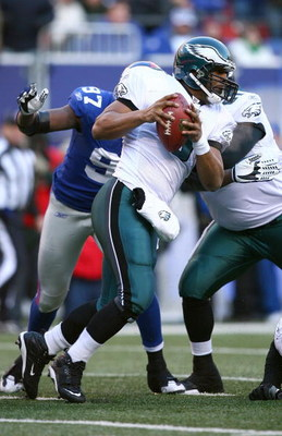 EAST RUTHERFORD, NJ - JANUARY 11:  Quarterback Donovan McNabb #5 of the Philadelphia Eagles scrambles in the pocket during the NFC Divisional Playoff Game against the New York Giants on January 11, 2009 at Giants Stadium in East Rutherford, New Jersey.  T