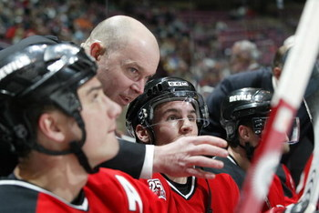 EAST RUTHERFORD, NJ - FEBRUARY 14:  Assistant coach John MacLean of the New Jersey Devils instructs his players during the game against the Montreal Canadiens at Continental Airlines Arena on February 14, 2007 in East Rutherford, New Jersey. The Devils wo