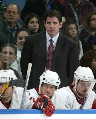 UNIONDALE, NY - NOVEMBER 22:  Head coach Peter Laviolette of the Carolina Hurricanes looks on against the New York Islanders on November 22, 2006 at Nassau Coliseum in Uniondale, New York.  (Photo by Jim McIsaac/Getty Images)