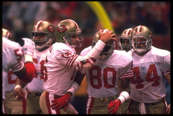 28 JAN 1990:  JOE MONTANA #16, QUARTERBACK FOR THE SAN FRANCISCO 49ERS, GREETS WIDE RECEIVER JERRY RICE #80 DURING SUPER BOWL XXIV AS RUNNING BACK TOM RATHMAN #44 AND OFFENSIVE LINEMAN JESSE SAPOLO #61 LOOK ON AT THE SUPERDOME IN NEW ORLEANS, LOUISIANA.
