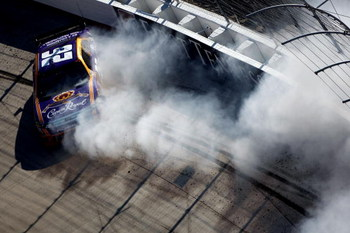 BRISTOL, TN - MARCH 22:  Jamie McMurray, driver of the #26 Crown Royal Ford, hits the wall during the NASCAR Sprint Cup Series Food City 500 at Bristol Motor Speedway on March 22, 2009 in Bristol, Tennessee.  (Photo by Chris Graythen/Getty Images)
