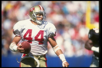 14 Oct 1990:  Running back Tom Rathman of the San Francisco 49ers moves the ball during a game against the Atlanta Falcons at the Fulton County Stadium in Atlanta, Georgia.  The 49ers won the game, 45-35. Mandatory Credit: Mike Powell  /Allsport