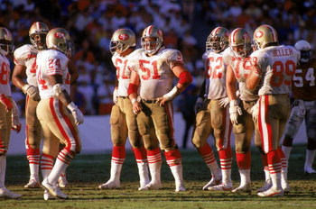 TEMPE, AZ - NOVEMBER 6: Center Randy Cross #51 of the San Francisco 49ers waits with his teammates for play to resume during a game against the Phoenix Cardinals at Sun Devil Stadium on November 6, 1988 in Tempe, Arizona.  The Cardinals won 24-23.  (Photo