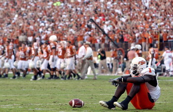 AUSTIN, TX - OCTOBER 25:  Wide receiver Dez Bryant #1 of the Oklahoma State Cowboys reacts after 24-28 loss against the Texas Longhorns at Texas Memorial Stadium on October 25, 2008 in Austin, Texas.  (Photo by Ronald Martinez/Getty Images)