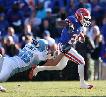 GAINESVILLE, FL - NOVEMBER 22:  Brandon James #25 of the Florida Gators breaks a tackle during the game against the Citadel Bulldogs at Ben Hill Griffin Stadium on November 22, 2008 in Gainesville, Florida.  (Photo by Sam Greenwood/Getty Images)