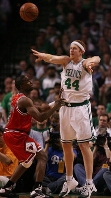 BOSTON - MAY 02:  Brian Scalabrine #44 of the Boston Celtics passes the ball as Ben Gordon #7 of the Chicago Bulls defends in Game Seven of the Eastern Conference Quarterfinals during the 2009 NBA Playoffs at TD Banknorth Garden on May 2, 2009 in Boston,