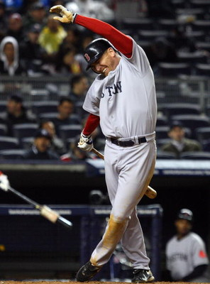 NEW YORK - MAY 04:  J.D. Drew #7 of the Boston Red Sox reacts after being hit with a pitch in the seventh inning against the New York Yankees on May 4, 2009 at Yankee Stadium in the Bronx borough of New York City.  (Photo by Jim McIsaac/Getty Images)