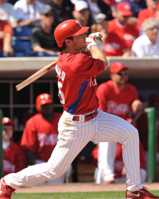 CLEARWATER, FL - FEBRUARY 26:  Infielder Jason Donald of the Philadelphia Phillies breaks a bat against the Toronto Blue Jays February 26, 2009 at Bright House Field in Clearwater, Florida.  (Photo by Al Messerschmidt/Getty Images)