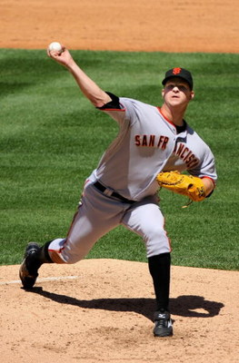 DENVER - MAY 07:  Starting pitcher Matt Cain #18 of the San Francisco Giants delivers against the Colorado Rockies during MLB action at Coors Field on May 7, 2009 in Denver, Colorado. Cain earned the win as the Giants defeated the Rockies 8-3.  (Photo by