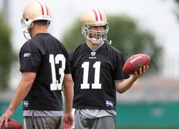 SANTA CLARA, CA - MAY 01:  Quarterbacks Alex Smith #11 and Shaun Hill #13 of the San Francisco 49ers look on during the 49ers Minicamp at their training facilities on May 1, 2009 in Santa Clara, California.  (Photo by Jed Jacobsohn/Getty Images)