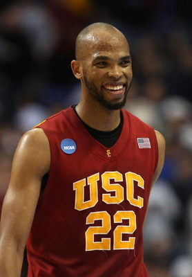 MINNEAPOLIS - MARCH 20:  Taj Gibson #22 of the USC Trojans smiles on court after USC's 72-55 win against the Boston College Eagles during the first round of the NCAA Division I Men's Basketball Tournament at the Hubert H. Humphrey Metrodome on March 20, 2