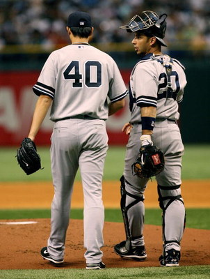 TAMPA, FL - JULY 14:  Starting pitcher Chien-Ming Wang #40 of the New York Yankees talks with catcher Jorge Posada #20 after Wang gave up three runs in the first inning against the Tampa Bay Devil Rays at Tropicana Field on July 14, 2007 in St. Petersburg