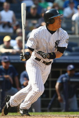 NEW YORK - JUNE 07:  Hideki Matsui #55 of the New York Yankees watches his hit getting Alex Rodrigez home against the Tampa Bay Rays during their game on June 7, 2009 at Yankee Stadium in the Bronx borough of New York City.  (Photo by Chris McGrath/Getty