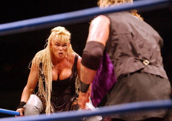 26 Oct 2001:  Luna Vachon eyes off the Vampire Warrior during the Black Wedding match at the WWA Wrestling 'Inception'  fight night held at the Sydney Superdome, Sydney, Australia.  DIGITAL IMAGE Mandatory Credit: Chris McGrath/ALLSPORT