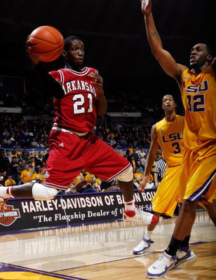 BATON ROUGE, LA - JANUARY 26:  Patrick Beverley #21 of the Arkansas Razorbacks passes the ball around Quinton Thornton #32 of the Louisiana State University Tigers on January 26, 2008 at the Pete Maravich Assembly Center in Baton Rouge, Louisiana.  (Photo