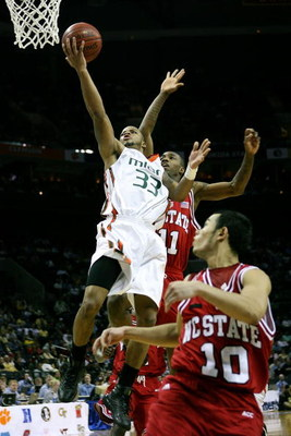 CHARLOTTE, NC - MARCH 13:  Jack McClinton #33 of the Miami Hurricanes shoots in front of Gavin Grant #11 of the North Carolina Wolfpack during Day 1 of the 2008 Men's ACC Basketball Tournament at Bobcats Arena on March 13, 2008 in Charlotte, North Carolin