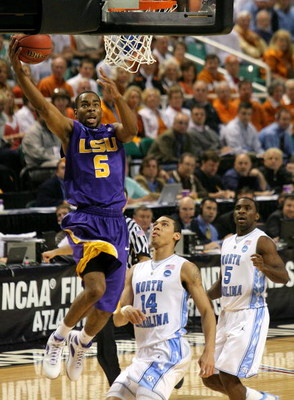 GREENSBORO, NC - MARCH 21:  Marcus Thornton #5 of the Louisiana State University Tigers lays in a basket against Danny Green #14 of the North Carolina Tar Heels during the second round of the NCAA Division I Men's Basketball Tournament at the Greensboro C