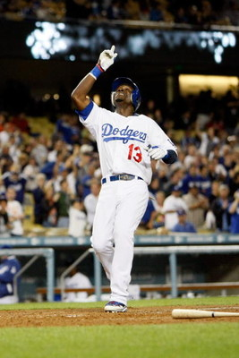 LOS ANGELES, CA - JUNE 09:  Orlando Hudson #13 of the Los Angeles Dodgers celebrates a solo homerun in the fifth inning against the San Diego Padres at Dodger Stadium on June 9, 2009 in Los Angeles, California. The Dodgers defeated the Padres 6-4.  (Photo