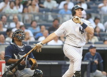 NEW YORK - JUNE 08:  Mark Teixeira #25 of the New York Yankees hits a solo home run in the first inning against the Tampa Bay Rays on June 8, 2009 at Yankee Stadium in the Bronx borough of New York City.  (Photo by Nick Laham/Getty Images)