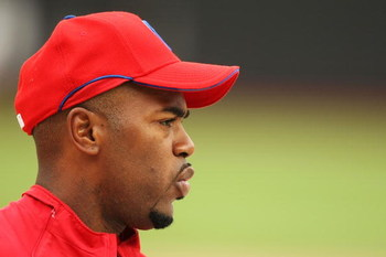 NEW YORK - JUNE 10:  Jimmy Rollins #11 of the Philadelphia Phillies looks on during batting practice before the game against the New York Mets on June 10, 2009 at Citi Field in the Flushing neighborhood of the Queens borough of New York City.  (Photo by A
