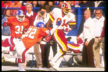31 Jan 1988:  Defensive lineman Tony Lilly #22 of the Denver Broncos tries to stop wide receiver Art Monk #81 of the Washington Redskins during the Super Bowl XXII game at the Jack Murphy Stadium in San Diego, California.  The Redskins won, 42-10.  Mandat