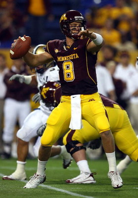 MINNEAPOLIS - SEPTEMBER 13:  Quarterback Adam Weber #8 of the Minnesota Golden Gophers drops back to pass against the Montana State Bobcats at the Metrodome on September 13, 2008 in Minneapolis, Minnesota.  (Photo by Jeff Gross/Getty Images)