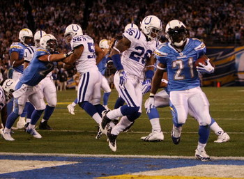 SAN DIEGO - JANUARY 03:  LaDainian Tomlinson #21 of the San Diego Chargers scores a touchdown against the Indianapolis Colts in the AFC Wild Card Game on January 3, 2009 at Qualcomm Stadium in San Diego, California.  (Photo by Stephen Dunn/Getty Images)