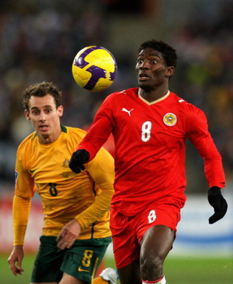 SYDNEY, AUSTRALIA - JUNE 10:  Jaycee Okwunwanne of Bahrain watches the ball during the 2010 FIFA World Cup Asian qualifying match between the Australian Socceroos and Bahrain at ANZ Stadium on June 10, 2009 in Sydney, Australia.  (Photo by Cameron Spencer
