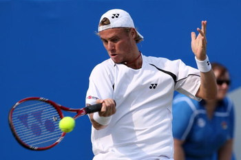 LONDON, ENGLAND - JUNE 11:  Lleyton Hewitt of Australia plays a forehand during the men's third round match against Andy Roddick of USA during Day 3 of the the AEGON Championship at Queens Club on June 11, 2009 in London, England.  (Photo by Hamish Blair/