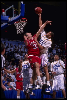 27 Jan 1996:  Forward Beau Zach Smith #33 of the Louisville Cardinals attempts to block a slam by forward J.R. Henderson #57 of UCLA Bruins at Pauley Pavilion in Los Angeles, California.  Louisville defeated UCLA 78-76.  Mandatory Credit:  Steve Dunn/Alls