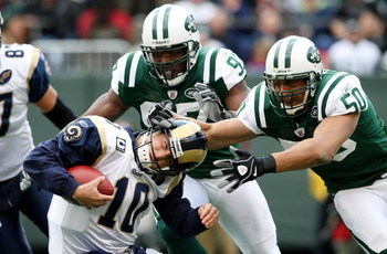 EAST RUTHERFORD, NJ - NOVEMBER 09: Calvin Pace #97 and Eric Barton #50 of the New York Jets sack Marc Bulger #10 of the St. Louis Rams at Giants Stadium on November 9, 2008 in East Rutherford, New Jersey.  (Photo by Nick Laham/Getty Images)