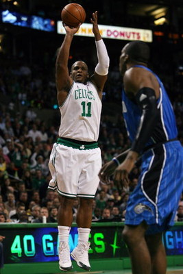 BOSTON - MAY 12:  Glen Davis #11 of the Boston Celtics takes a shot as Dwight Howard #12 of the Orlando Magic defends in Game Five of the Eastern Conference Semifinals during the 2009 NBA Playoffs at TD Banknorth Garden May 12, 2009 in Boston, Massachuset