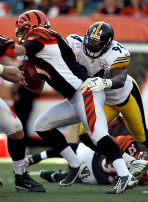 CINCINNATI - OCTOBER 19:  Lawrence Timmons #94 of the Pittsburgh Steelers sacks Ryan Fitzpatrick #11 of the Cincinnati Bengals during the NFL game at Paul Brown Stadium on October 19, 2008 in Cincinnati, Ohio.  (Photo by Andy Lyons/Getty Images)