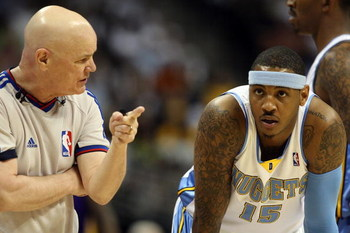 DENVER - MAY 29:  Referee Joe Crawford talks with Carmelo Anthony #15 of the Denver Nuggets in Game Six of the Western Conference Finals during the 2009 NBA Playoffs against the Los Angeles Lakers at Pepsi Center on May 29, 2009 in Denver, Colorado. NOTE