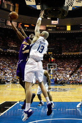 ORLANDO, FL - JUNE 11:  Lamar Odom #7 of the Los Angeles Lakers puts a shot up against Marcin Gortat #13 of the Orlando Magic in Game Four of the 2009 NBA Finals on June 11, 2009 at Amway Arena in Orlando, Florida.  NOTE TO USER:  User expressly acknowled