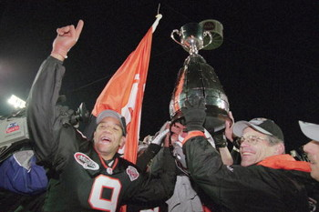 26 Nov 2000:  Damon Allen #9 of the British Columbia Lions celebrates after the Grey Cup 2000 game against the Montreal Alouettes at the McMahon Stadium in Calgary, Alberta, Canada. The Lions defeated the Alouettes 28-26.Mandatory Credit: Craig Klem  /All