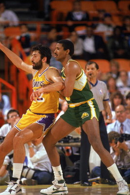 LOS ANGELES - 1990:  Steve Johnson #33 of the Seattle Supersonics and Vlade Divac #12 of the Los Angeles Lakers battle for position during a game in the 1989-1990 NBA season at the Great Western Forum in Los Angeles, California.  (Photo by Ken Levine/Gett